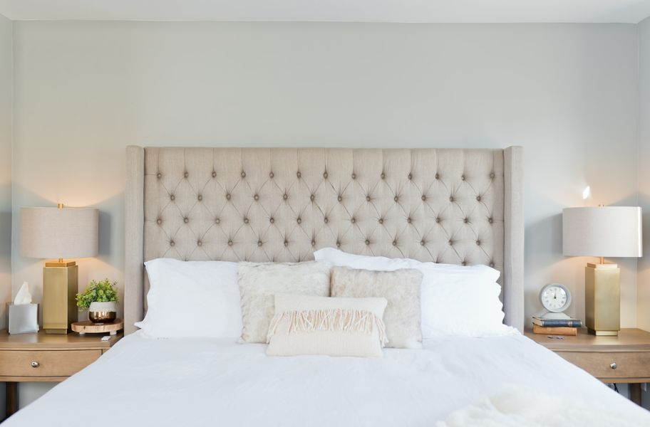 White bedding with cushions