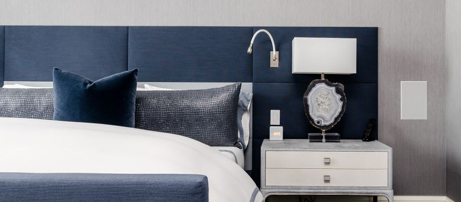 Bed with large blue headboard