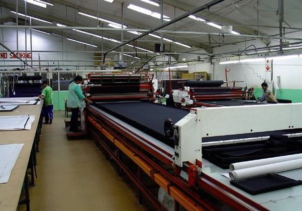 Fabric lay up and cutting in a linen factory