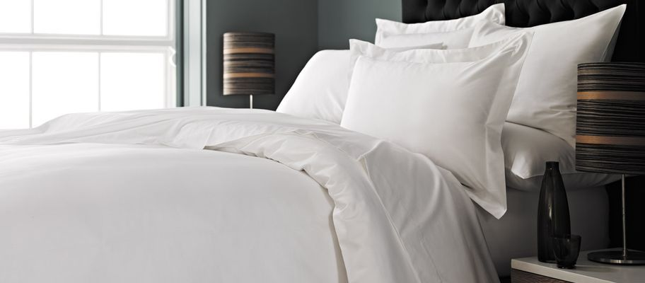 White bedding with black headboard