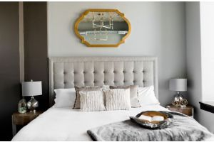 White bedding with gold mirror