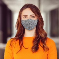 Woman wearing Martex Health leopard print grey coloured reusable face mask with antimicrobial protection.