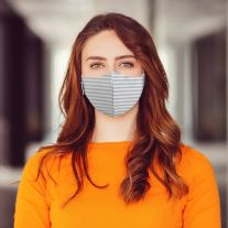 Woman wearing Martex Health grey striped reusable face mask with antimicrobial protection.