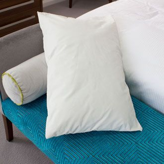 Waterproof pillows with flame retardant protection